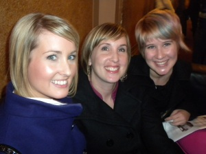 Three blonde haired happy young ladies.