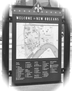 New Orleans welcome sign with city map