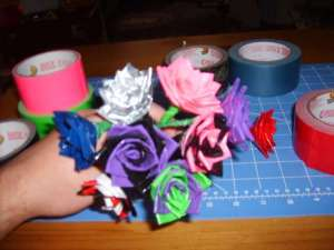 Rolls of colored duct tape and a bouquet of duct tape roses