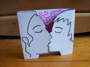 Card showing silhouette of two people kissing
