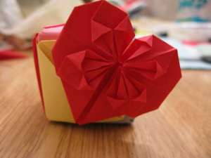 Bright red origami heart