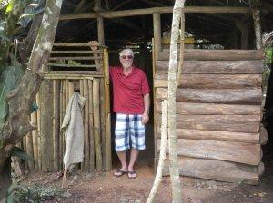 Bruce standing in the door of the medicine hut