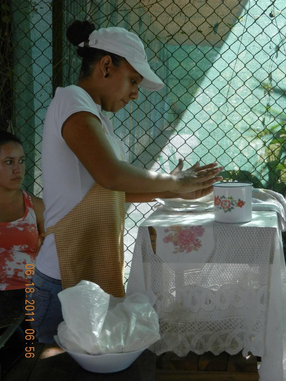 Young woman making fresh tortillas