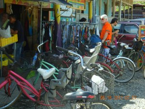 Bruce in his bright orange shirt among the multitude of bikes parked at the feria.